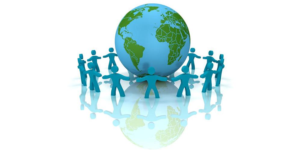 手を繋いで地球儀を囲む仲間たち